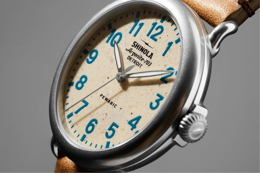 Detail shot showing the clay dial on a Shinola X Pewabic Runwell Detail shot showing the clay dial on a Shinola X Pewabic Runwell